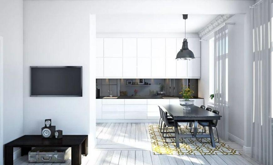 Кухня совмещённая с залом в светлых тонах.