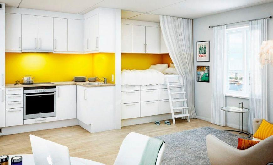 Кухня квартиры-студии в светлых тоннах.