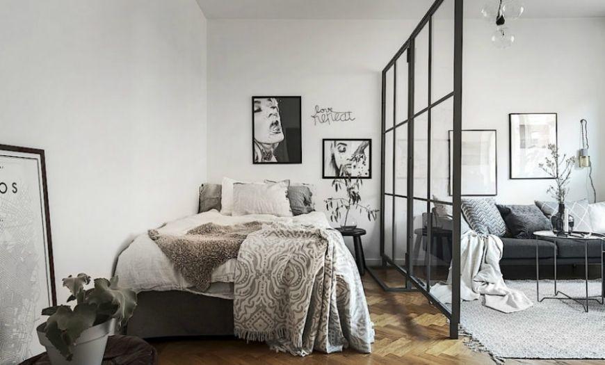 Спальное место в квартире-студии в тёмных тоннах